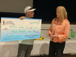 Pete Squibb, Sanibel FlyFishers President, presents our first $5000 check to June Stine of FGCU on behalf of the SFF/FGCU Water School Scholarship Fund created in 2019.