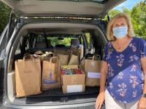 Zontian Judy Baran with a carload of donations