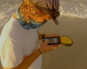 SCCF Biologist Jack Brzoza uses Trimble GPS. Photo by Tom James of Pelican Media