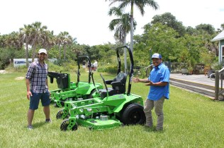 SCCF's Justin Proctor, left, and TLS Landscape Owner Justin Tetho show the Mean Green mower brought by Sarlo Power Mowers. Photo by Shannen Hayes