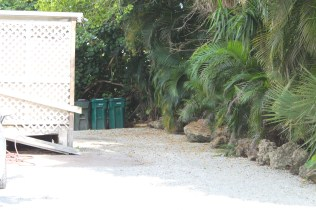 The Sandbar's dumpster had been in the area behind the building before the trash company refused service there due to lack of access from landscaping rocks on the neighboring property of Nutmeg Condominiums.