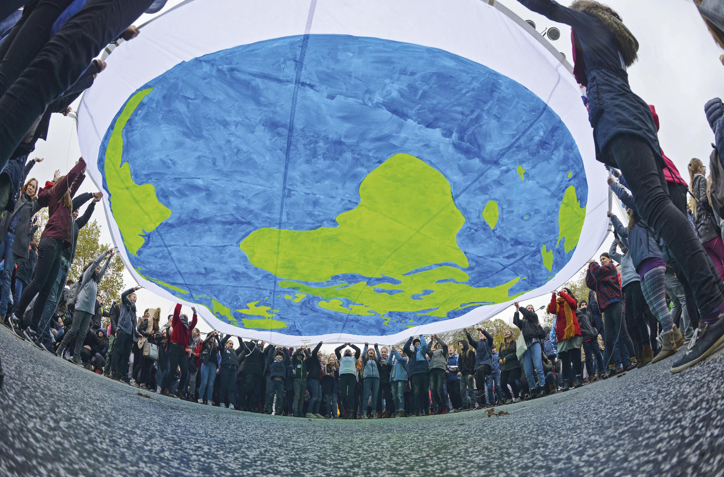 Manifestantes na Conferência das Nações Unidas sobre Mudança Climática COP23, 2017, Bona, Alemanha.