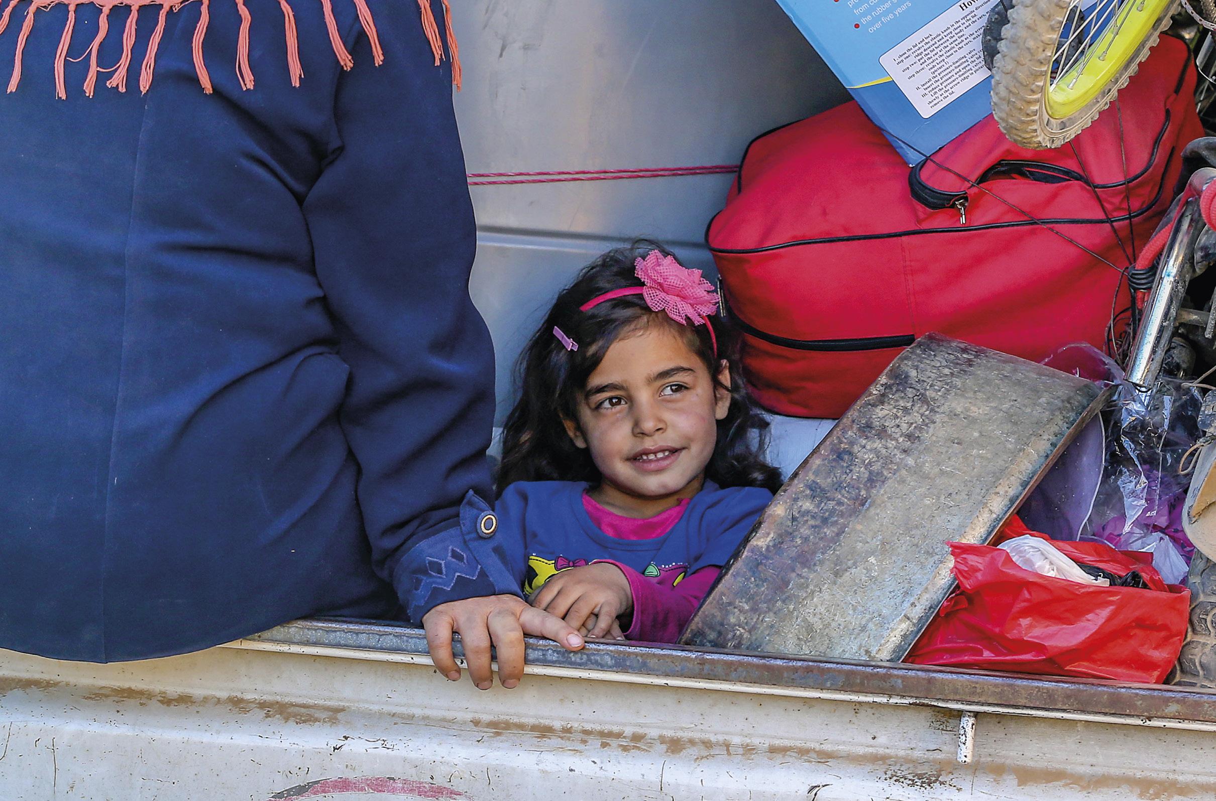 Refugiados sírios num campo de refugiados no Líbano. Segundo o ACNUR haveria, em julho de 2018, 1.011.366 refugiados sírios registados no Líbano. Foto EPA/NABIL MOUNZER