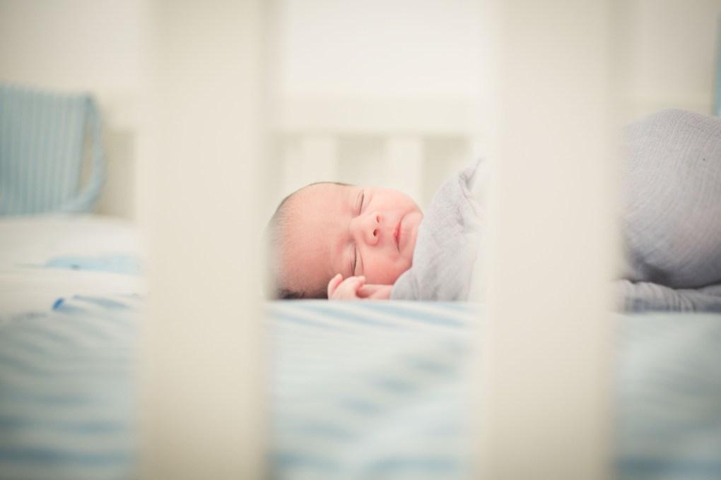 baby asleep in cot, baby asleep in crib, newborn photography