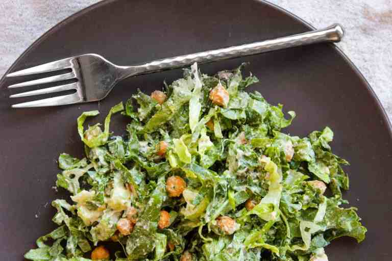 vegan caesar salad with crispy chickpeas on a plate