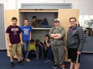 Kaden's project at the Sapulpa High School Band Room L to R Kaden Jackson, Evan Linfoot, Isaac Cearley, Nick Lynam, Cody Edwards, Nickey Cooper, Gabe Jackson & Jett Jordan on the shelf.