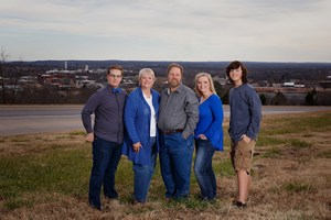 Cheryl (second from the left) pictured with her son Gabe, her husband Dennis, daughter Caroline and son Kaden.