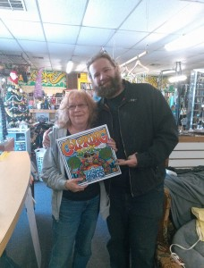 "Price Jones, right,  poses with the first ""Grown Folk"" coloring book going to his very first Kickstarter backer."