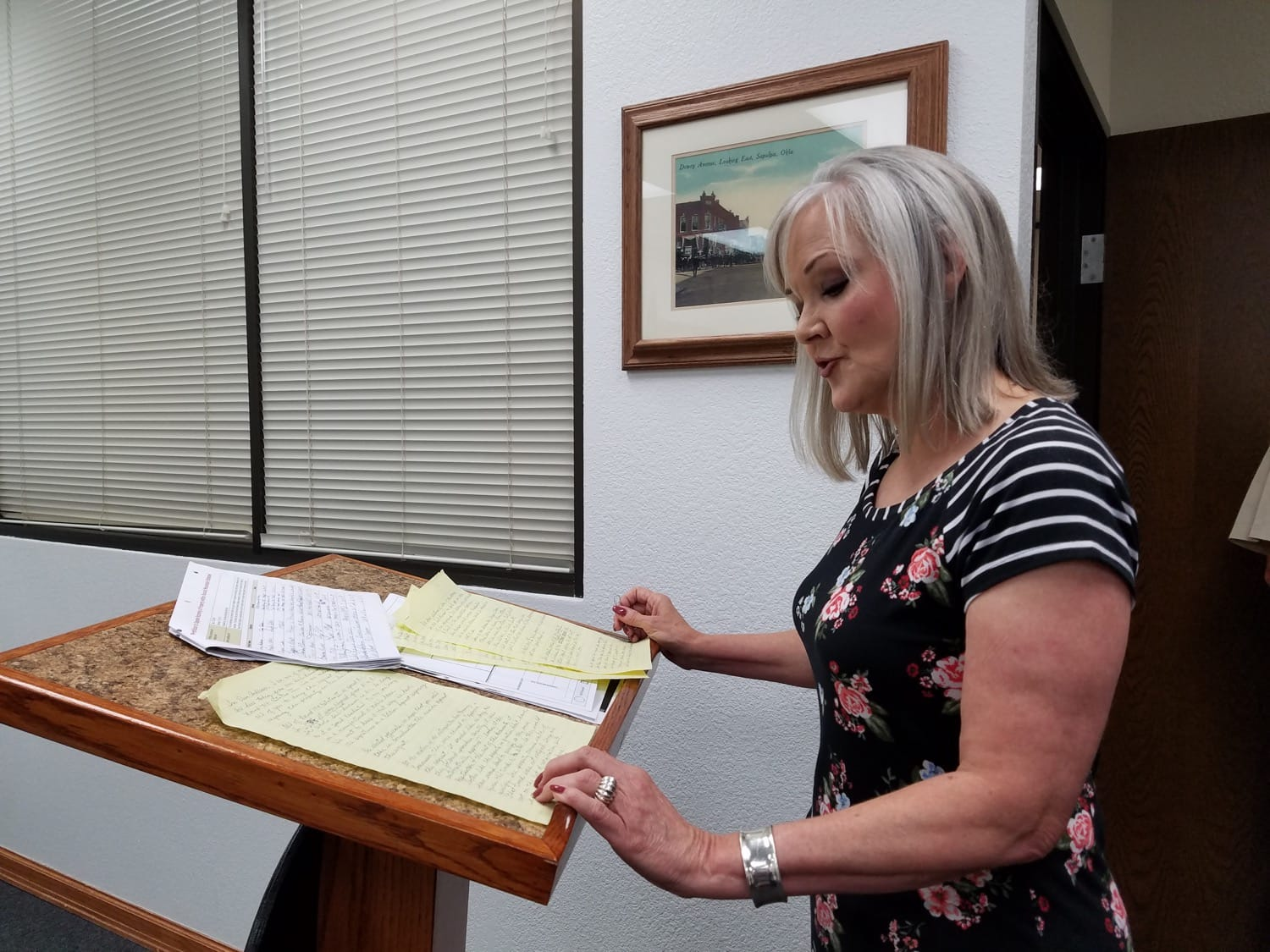 Elisa Anderson speaks at Monday's County Commissioners meeting. Anderson has a petition of 102 signatures asking the County not to allow a mobile home in their Sand Springs neighborhood.