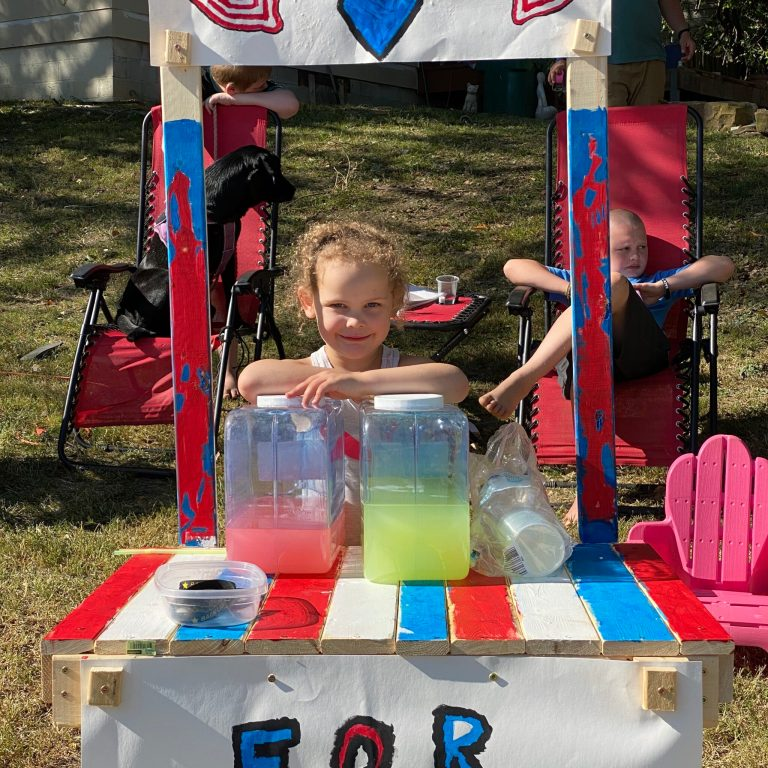 PHOTOS: Local five-year-old raises nearly $450 for police in six hours at lemonade stand