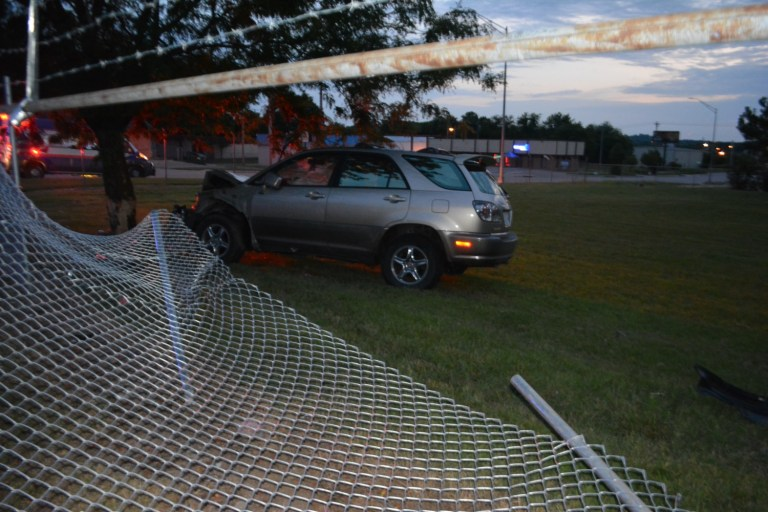 Man plows SUV through a fence and into a tree on North Hickory
