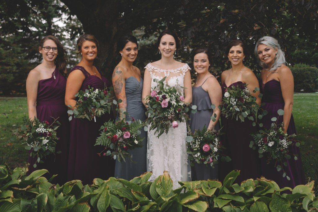 Jewel toned, October wedding with airy, greens and roses bouquets photographed at Barn on the Hill in Leaf River, Illinois by Sara Anne Johnson.