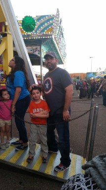 Caleb and dad in line for the Ferris Wheel. I was pregnant and couldn't ride, and Joe is afraid of heights.