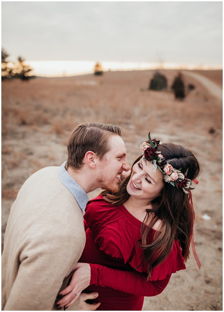 Cute couple laughing in Brighton Michigan for maternity photos