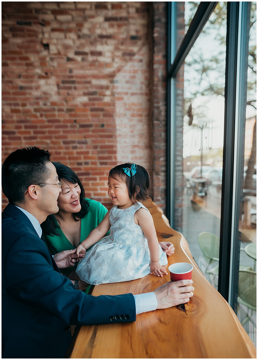Family sitting inside Uptown Coffeehouse in Howell