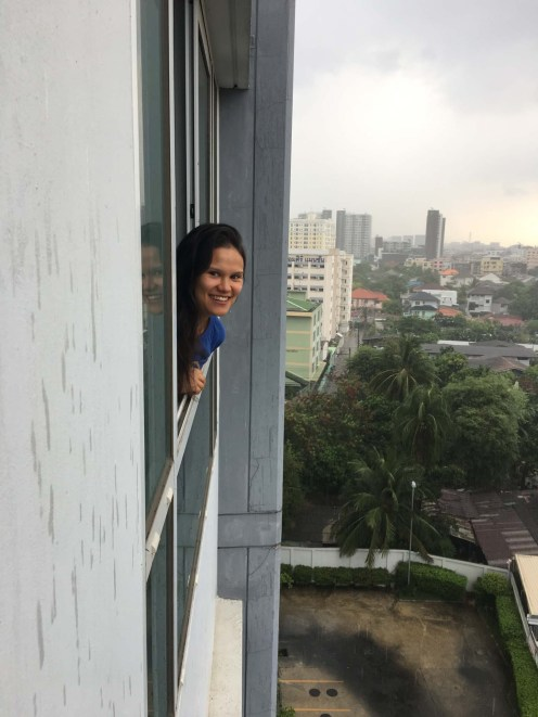 Sarah peeking out from our Bangkok apartment.