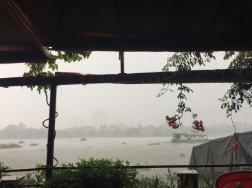 Rainy day in a restaurant along the river.