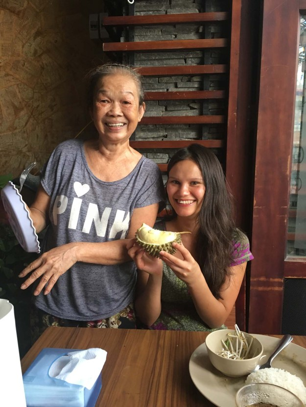 Sarah made fast friends with the restaurant owner who shared durian with us.