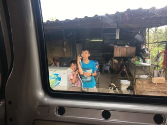 On the two-hour drive to our Mekong Delta tour. Our driver stopped to see if we wanted to buy snakes or rats from these young boys to eat later.