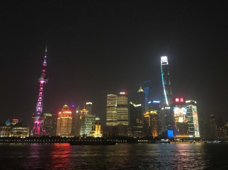 View from the Bund at night. Visible from left to right is the Oriental Pearl TV Tower, Bottle Opener and Shanghai Tower.