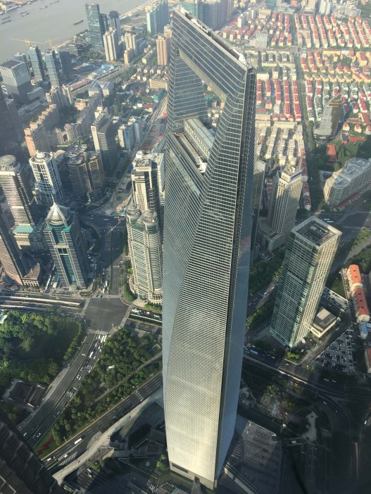 "View from Shanghai Tower, looking at the ""Bottle Opener"" building (Shanghai World Financial Center building, 492m tall, 5th tallest building in Asia)."