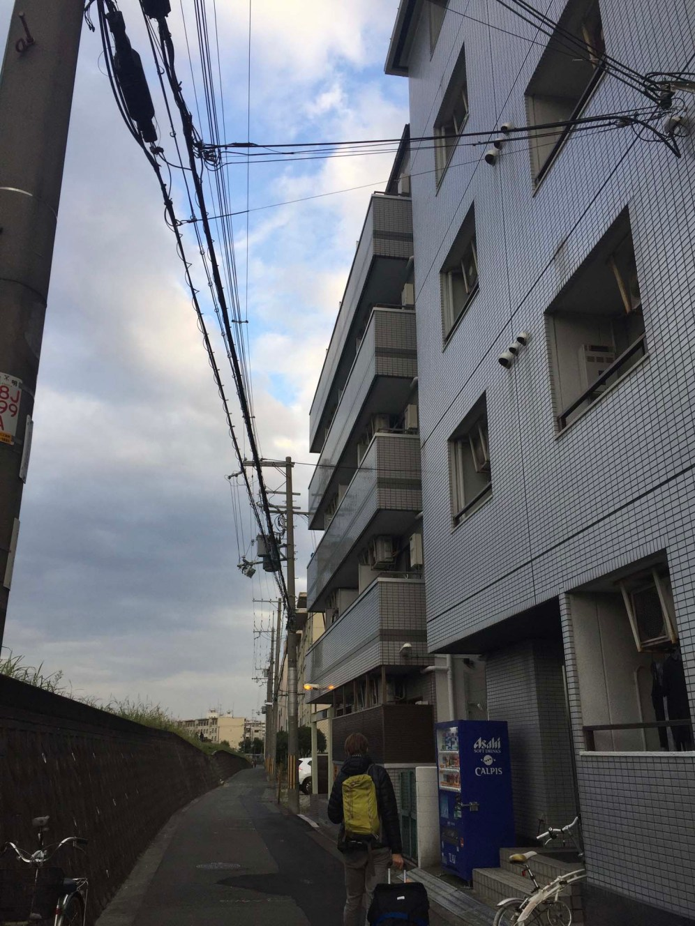 Our apartment building in Northern Osaka. We are on the second floor with a river view. $30 Canadian a night!