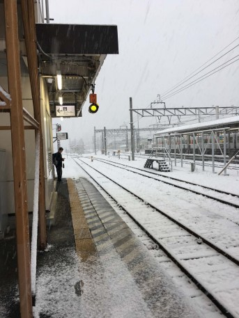Snow day at the train station. Nothing stops the trains though.