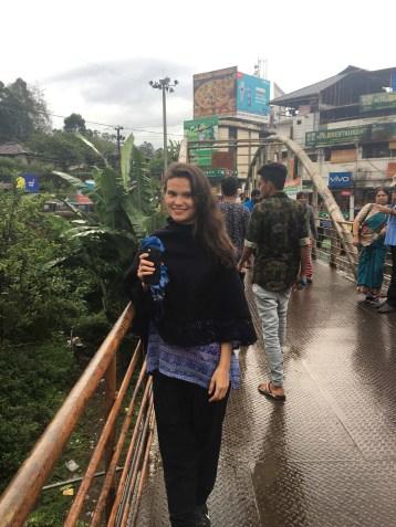 Sarah on the pedestrian bridge between rainstorms.