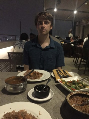 Beautiful thunderstorms in the distance were visible from this rooftop restaurant downtown. I'm happier than I look.