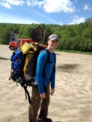 Sherpa Mike carrying two packs...and a truck