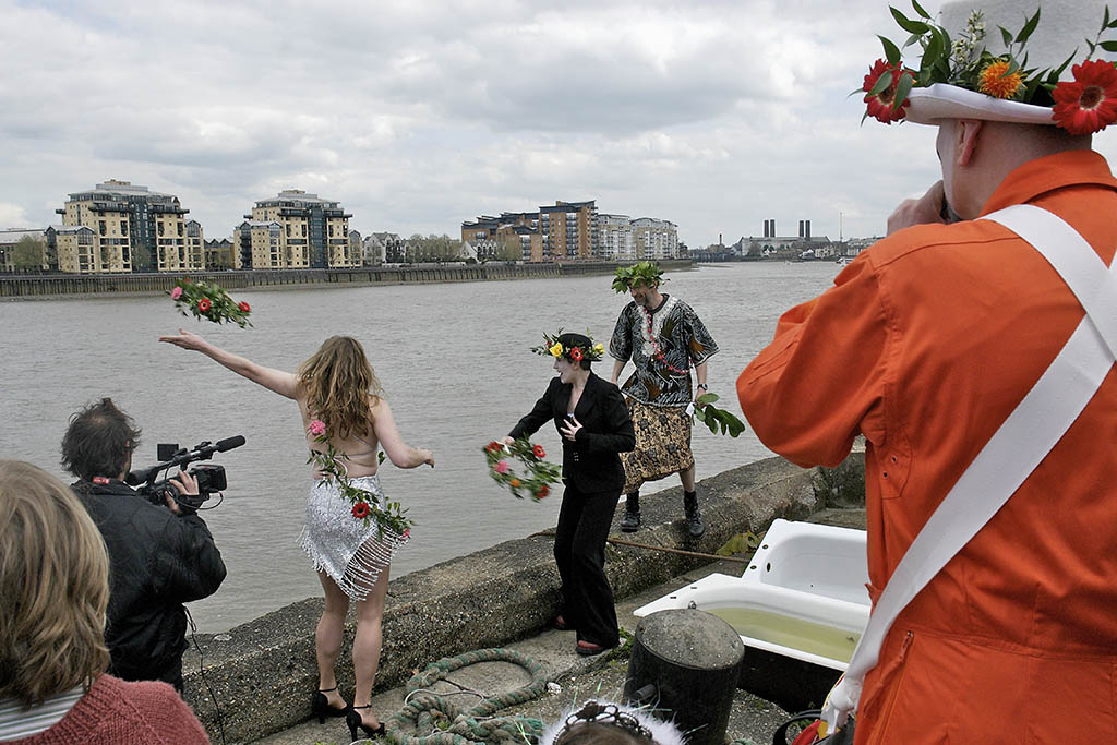 Offering flowers to the Thames, Deptford Jack in the Green, London