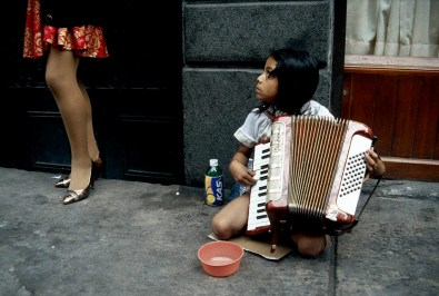 Otomie Indian girl busking, Mexico City