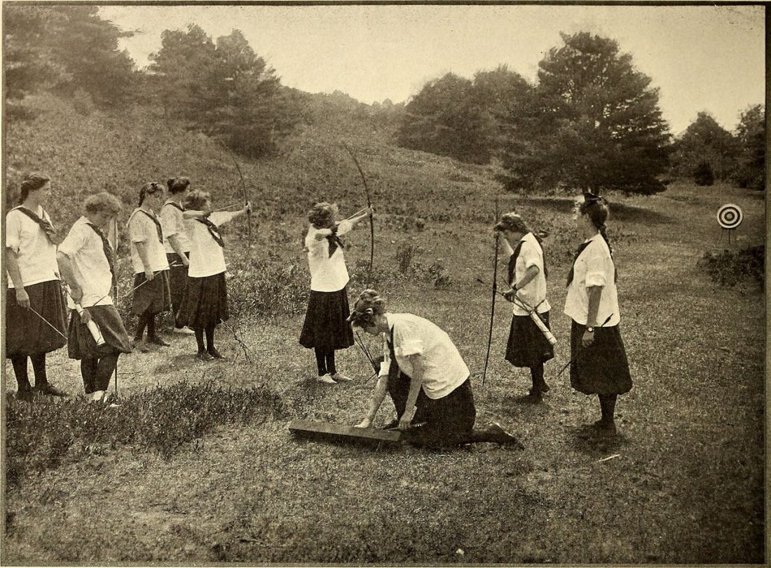 "Girls doing archery. Illustration from the November, 1912 issue of ""American Homes and Gardens."""