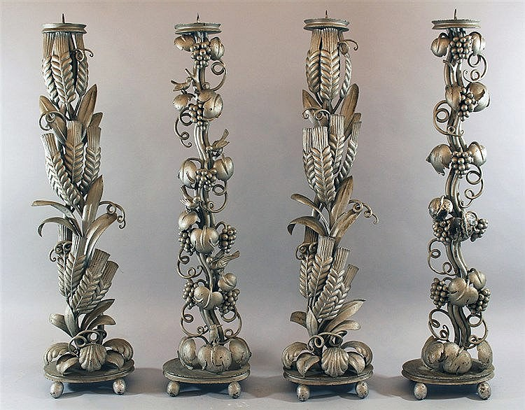 Four large candlesticks. Early 20th c.