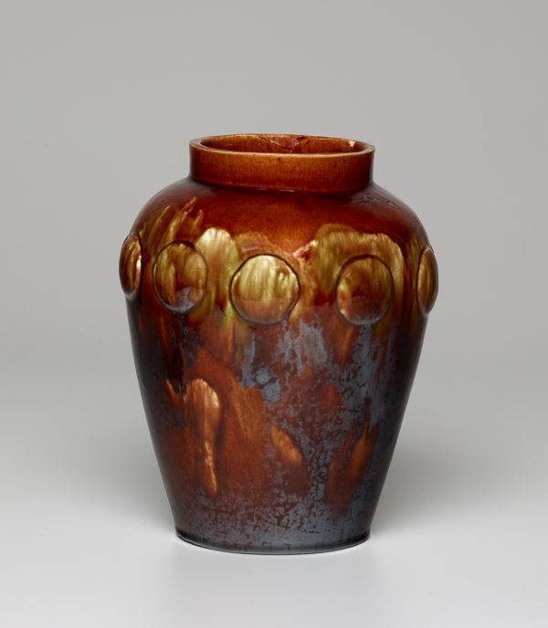 Vase with raised medallions. 1919.