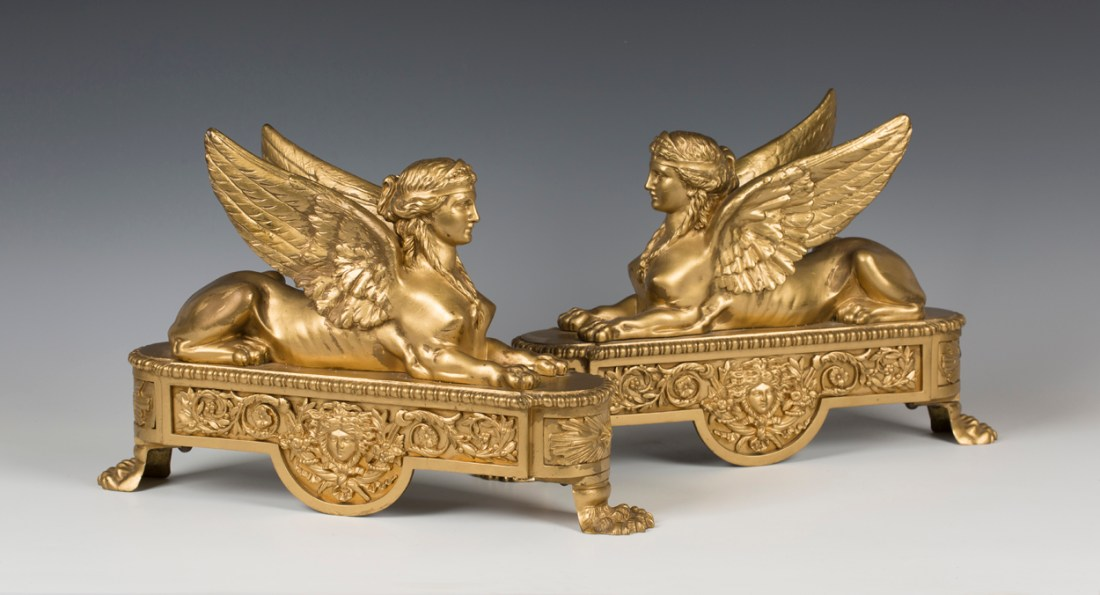 Pair of chenets (firedogs). French Empire. Early 18th c.