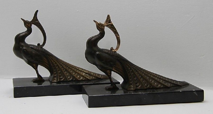 Pair of bronze peacock bookends on marble bases. Art Déco.
