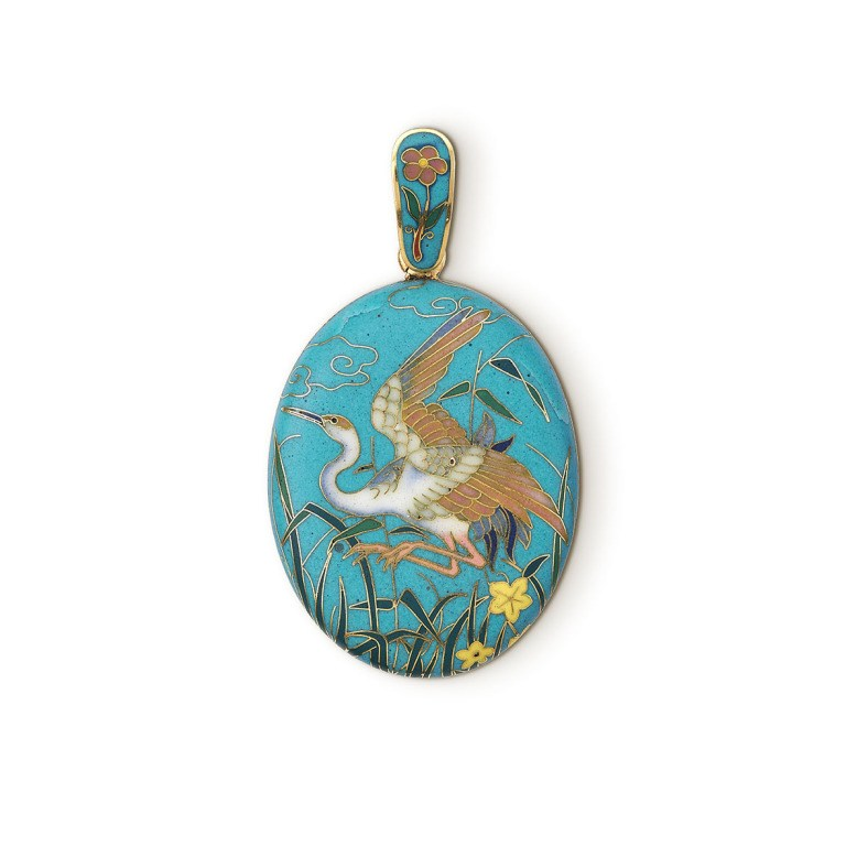Pendant locket showing a crane about to land on reeds.