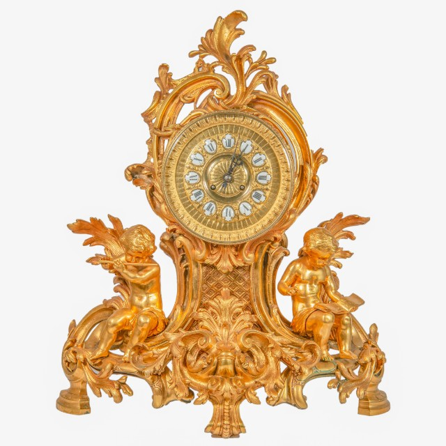 Ormolu clock set with putti. 19th c.