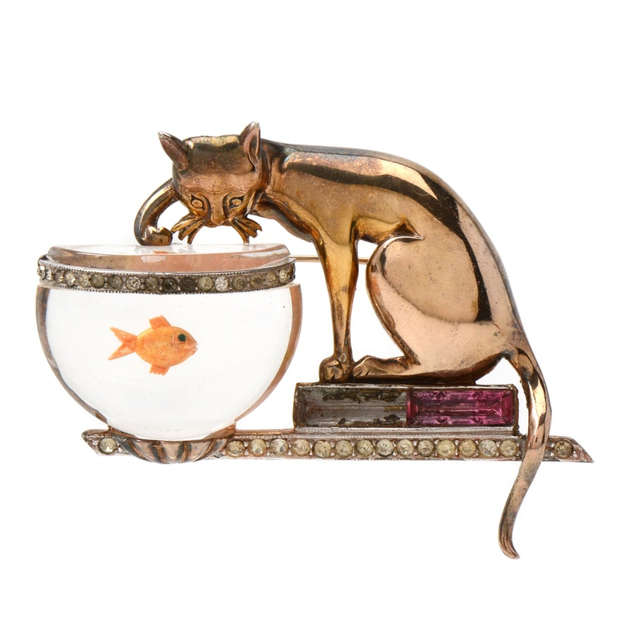 """""""Jelly Belly"""" cat and goldfish brooch featuring a cat with it's paw in a goldfish bowl. ca. 1948."""