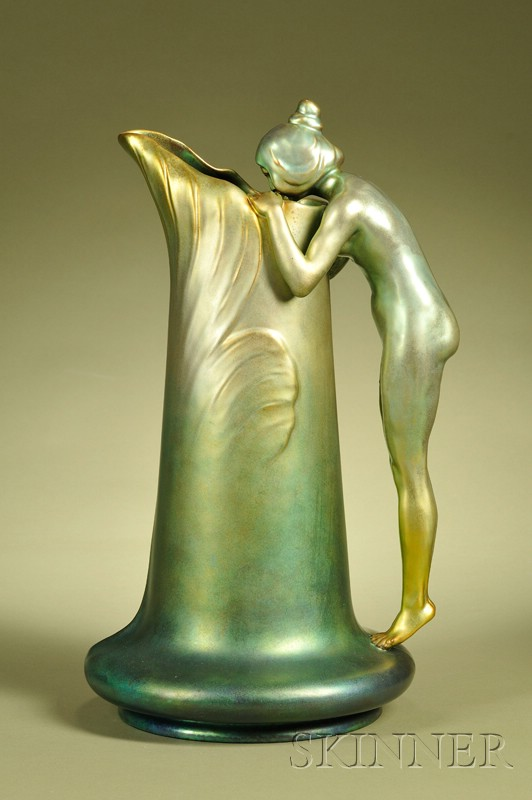 Ewer with a handle in the motif of a nude female drinking from the spring. ca. 1900.