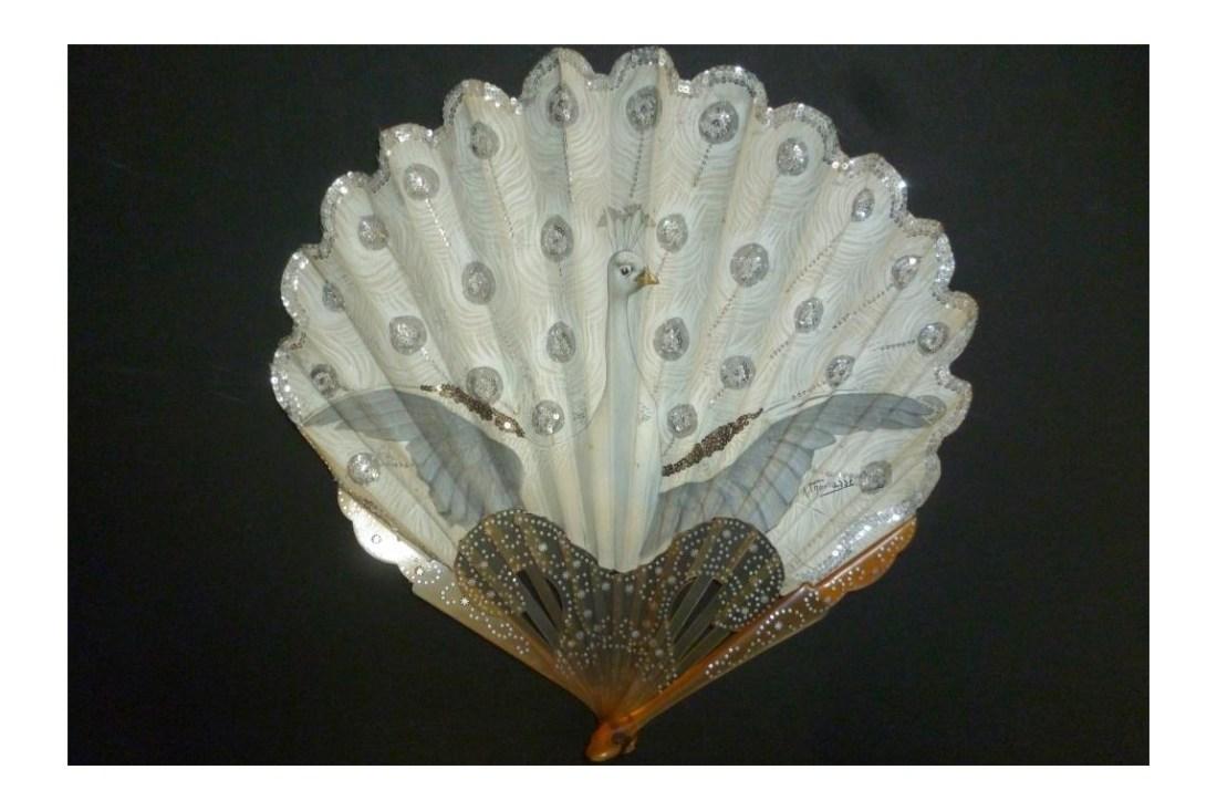 Fan in the motif of a white peacock. ca. 1905.