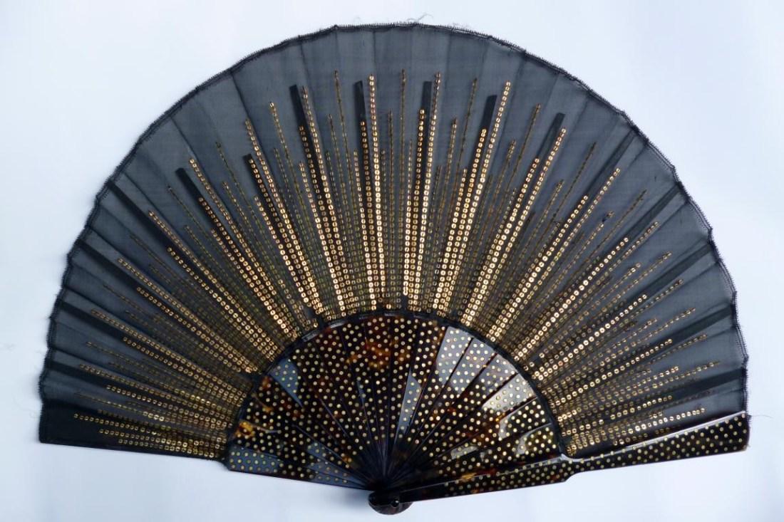 Balloon fan, black fan with a sunray motif. Early 20th c.