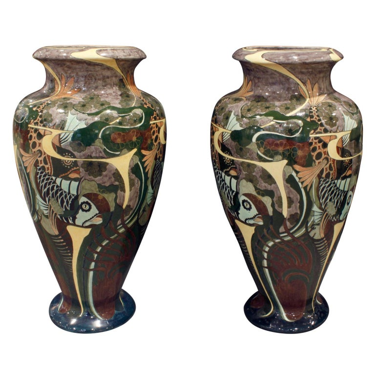 Pair of ceramic vases. ca, 1896. Hand-painted.