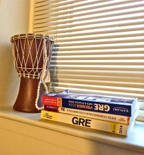Study materials that prepare Elisa for her GREs and her engineering exam sit next to a memento that she got while in Cameroon, Africa, this past summer.
