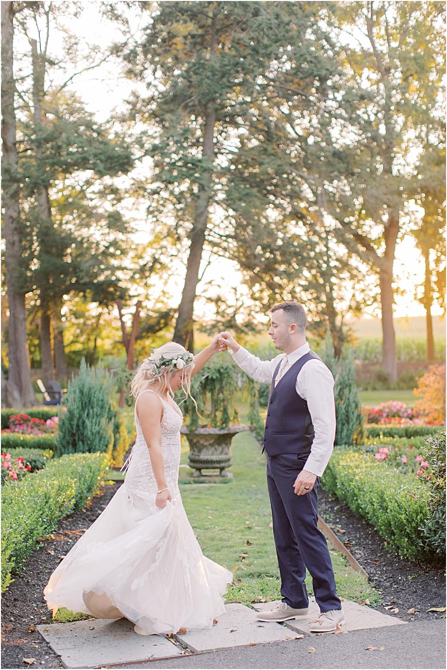 groom twirling bride | hotel du village wedding