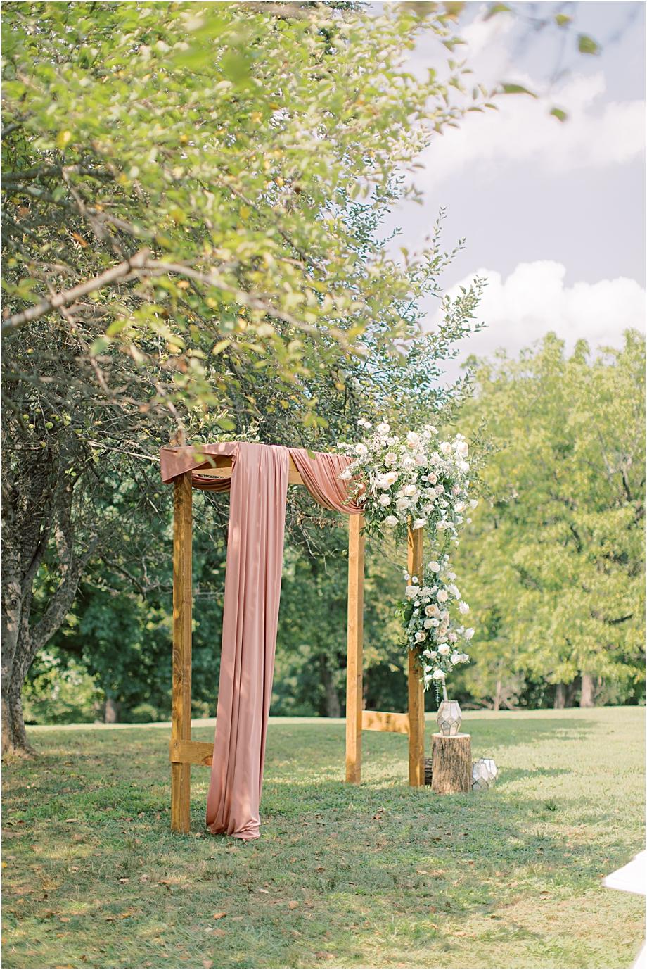 floral ceremony arch | John James Audubon Center Wedding