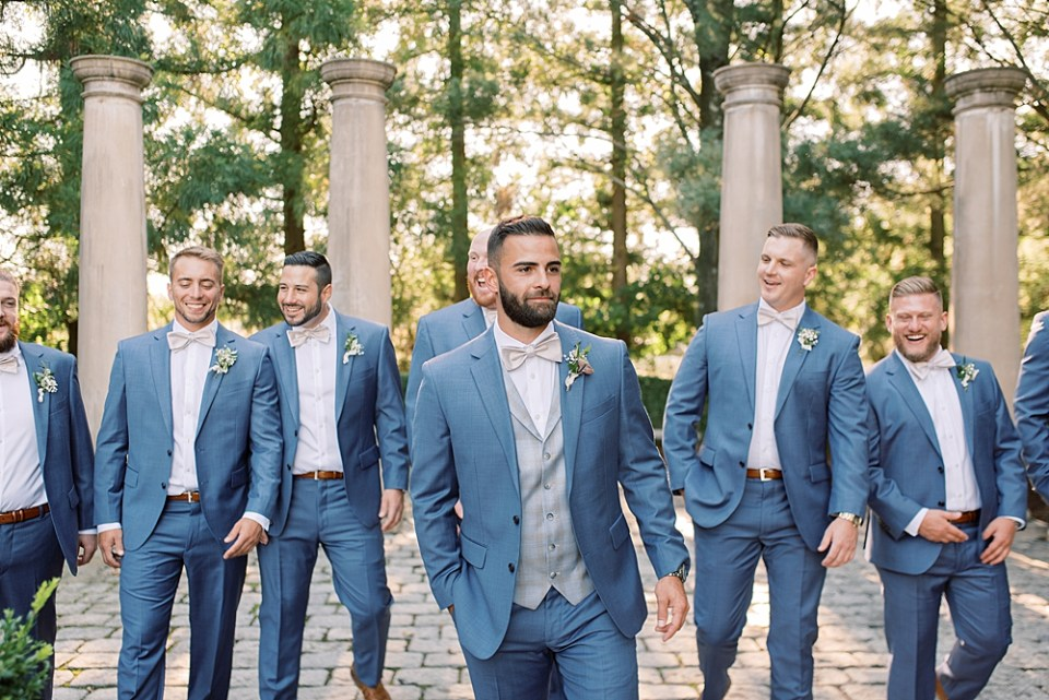 blue and silver groom attire | groom walking with groomsmen | sarah canning photography