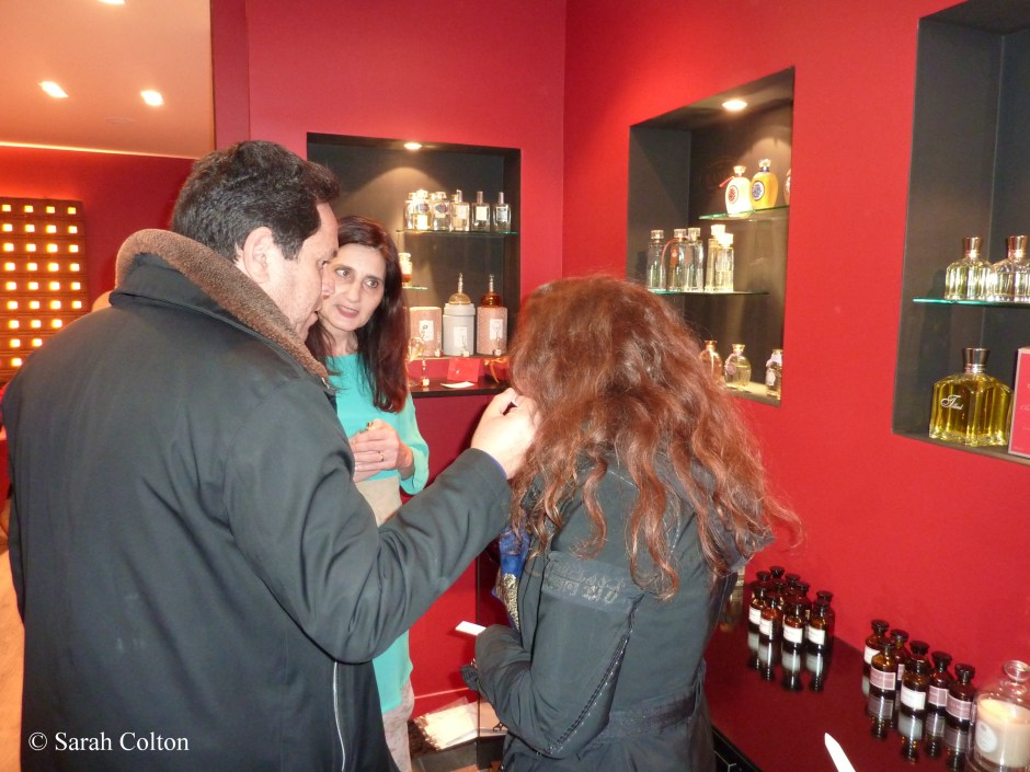 Stefania Giannino of Nobile 1942 looks on while guests sample a fragrance.
