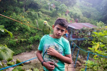 Boy-and-parrot-Sierra-Nevada-Colombia-1